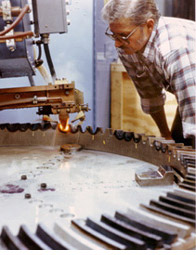 Bill Brown inspecting large gear